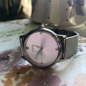 Silver Guess Watch with mesh band.